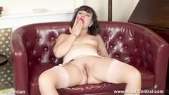 Naughty Milf strips off lingerie wanks in stockings heels Thumb