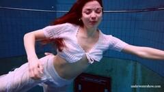 Sweet Polish hottie Marketa naked in the pool Thumb