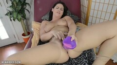 Sensual brunette toys her pussy Thumb