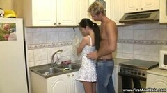 Brunette is cleaning the kitchen but gets a better offer Thumb