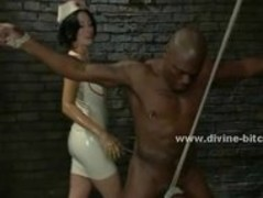 Strong black slave immobilized with ropes by pervert mistress in Thumb