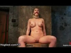 Bound to the chair babe tits flogged in dungeon Thumb