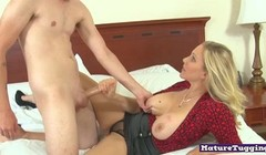 Cocktugging milf with big knockers jerks dick Thumb