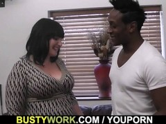 Busty lady boss in fishnets loves black meat Thumb