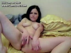 Brunette beautiful girl with nice tits fingering her pussy Thumb