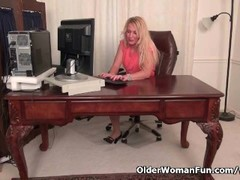 American milf Shelby stripping off at the office Thumb