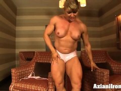 Big bodybuilder flexes her huge muscles as she strips out of her lingerie Thumb