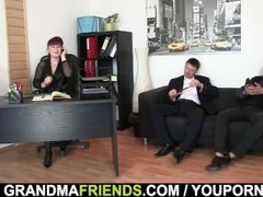 Business lady spreds her old pussy for 2 cocks Thumb