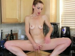 Skinny sexy milf betty blaze masturbates in the kitchen Thumb