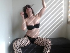 Smoking small cigar, wearing my fishnet pantyhose I rub my clit. Thumb
