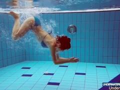 Redhead in blue bikini showing her body Thumb