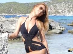 Topless natural Bikini Babe strips on the beach! Thumb
