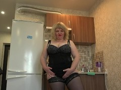 a mature milf with huge tits and a hairy pussy, a rider on a dildo Thumb