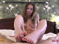 Great footjob with red nails makes his cock cum. Mia Bandini Thumb