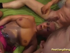 gangbang orgy with busty tattooed milf Thumb