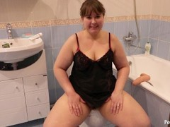 plump, with a dildo while sitting on the toilet Thumb