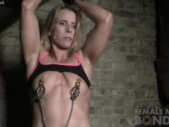 Naked Female Muscle Cougar in Pain from Nipple Clamps Thumb