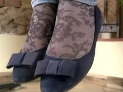 Teen feet in socks with white nail polish Thumb