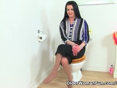 British milf Sarah Kelly takes care of her needs on toilet Thumb