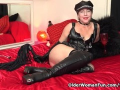 American milf Justine wants to play in leather lingerie Thumb