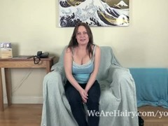 Alexis May strips naked on her blue chair Thumb