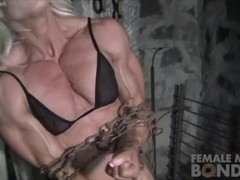 Ripped Female Bodybuilder in Chains Straining Her Muscles Thumb