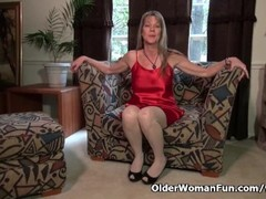American milf Lucky has lots of fun with a red dildo Thumb