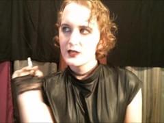 Submissive Sissy Goth Princess Smoking In A Shiny Skintight Vinyl Bodysuit Thumb